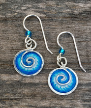 """Ocean waves and waterfalls emit feel-good negative ions. These blue wave earrings may not emit ions, but wearing them does promote hope and peace. They are handmade out of sterling silver and resins, and are carefully hand painted. They measure 3/4"""" tall x 1/2"""" wide. They are light and fun to wear."""