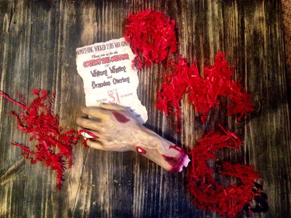 for a wedding i planned on halloween of 2013 i designed bloody zombie hand invitations after getting a few samples of zombie hands i found a company
