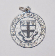 Sterling silver charm featuring Shattuck - St. Mary's Shield.  5/8 inch round.  Nice addition to your collection.