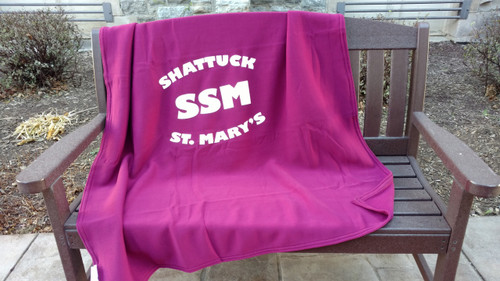 This maroon heavyweight stadium throw is extra soft like your favorite sweatshirt. Features screenprinted SSM logo. Snuggle up in team spirit while you cheer for your favorite team! Machine washable polyester.