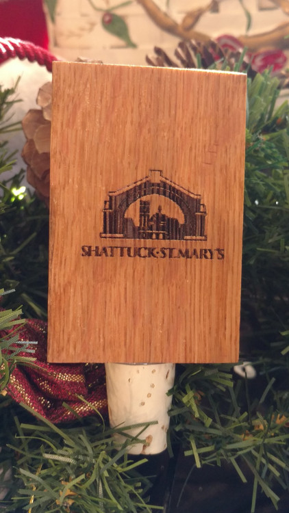 Our beloved Arch logo laser engraved on wood from a wine barrel!  Measures 2x4x1 inch.