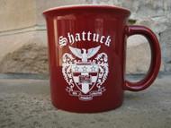 Maroon mug with Shattuck shield logo.