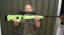 Guy with Zombie Army Sniper rifle in radioactive green inc scope & bipod