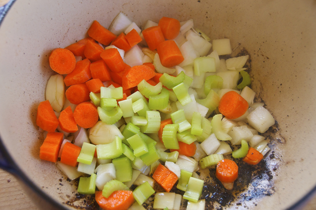 chopped fresh vegetables with italian seasonings in dutch oven
