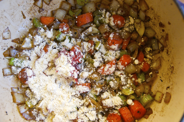 tomato paste, flour and vegetables in dutch oven