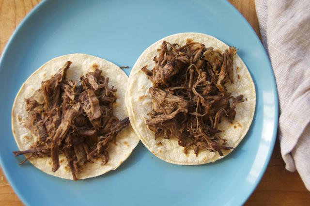 add shredded beef on tortillas