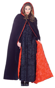 This sleek cape will make a great addition to your Halloween costume! This deluxe 63 inch velvet cape is black and has attached hood. Cape has satin embossed red lining.