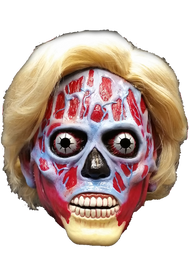 Trick or Treat Studios is proud to present the Official They Live Alien Hillary Clinton Edition Halloween Mask. From Director John Carpenter and starring Rowdy Roddy Piper, They Live follows Nada, who discovers the ruling class within the elite are in fact aliens managing human social affairs through the use of subliminal messages in mass media and are concealing their appearances through the use of a signal on top of a major TV broadcast station. They Live thrilled audiences in 1988 and now in 2016, They Live is more timely than ever. With the upcoming 2016 election on the horizon, one must question if, just like in They Live, the Presidential candidates are in fact Aliens supporting the elite class. Now you can get the second in a very limited collection of They Live Alien Masks made to look like the Presidential hopefuls. Again, this is a very limited run, so make sure to get your Hillary Clinton They Live Alien Mask today.  They Live is a trademark and copyright of Universal Studios. Licensed by Universal Studios LLC. All rights reserved.
