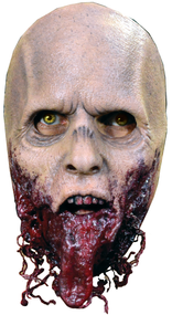 Straight from the screen of AMC's The Walking Dead comes a Halloween Face Mask from one of the most recognizable Walking Dead Walkers, The Jawless Walker. The Jawless Walker is a highly detailed face mask that includes a hanging tongue and shredded flesh that dangles from the mask. Sculpted by Neal Kennemore, the Artist that sculpted a number of The Walking Dead Walkers for Universal Studios Halloween Horror Nights - The Walking Dead Maze, and drawn from hundreds of screen references, the Jawless Walker Face Mask looks like it came right off the screen of The Walking Dead. So get yourself the Officially Licensed The Walking Dead Jawless Walker Face Mask, our Walker Chest, and some torn up clothes and go out and stalk the living this Halloween!