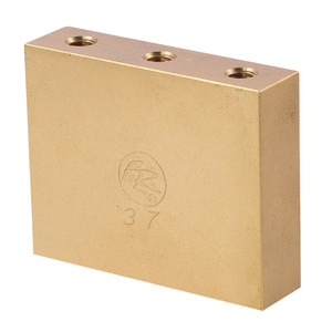 """This """"Fat"""" brass big block will add mass and sustain to your Floyd Rose bridge along with the tonal qualities of brass. Works with Floyd Rose Original, Non-Fine Tuner, 7-String*, 1000 Series*, and Special* tremolo systems. Width is 50.15 mm and thickness is 12.90 mm. Brass has been a much desired material for guitar luthiers dating back to the invention of the instrument; it is notorious for increasing warmth and clarity simultaneously, a rare combination. While greatly strengthening chord clarity and beefing up individual tones, it also greatly improves resonance, especially in the midrange of the instrument. All of these improvements are accompanied with the undeniably vintage sound and feel of this time-tested material. Since this block is larger than a conventional sustain block, it can also limit upward travel of the tremolo and can be set to rest against the body in a blocked bridge configuration. For floating bridge setup this block may require some routing in the spring cavity. *The Special 7-String Tremolo Systems have a sustain block mounting hole spacing which is unlike any of our other systems - for this reason, they can only function with their factory installed sustain blocks. These blocks will NOT function on the 1000 Series Pro 7-String!"""