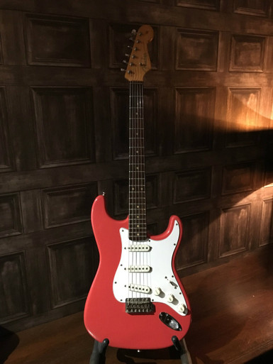 "<p>Viewing by appointment only. Please ask us for further photos if required.</p> <p>Original 1962 Fender Stratocaster in Fiesta Red. This is a one owner guitar from new with full provenance provided. We have carried out a full inspection of this guitar the finding of which are detailed below. </p> <p>Although there are things that have been changed with this guitar the one owner provenance adds a great deal of value and we are positive that you will never again have the opportunity to buy a 1 owner 62 strat ever again. All of the changes made to this guitar have been through pride and use.... when the logo became damaged it was replaced, when it started to look battered it was repainted, this has been one mans pride and joy for over 50 years and has been therefore treated with the respect he believed it deserved.....of course to the collector who wants a case queen this is not the guitar for them...but for a player/collector who wants to feel the mojo and love lavished on a guitar over 50 years then you will simply not find a better sounding and playing example.</p> <p> </p> <p>To add some interest to this instrument we have been advised by the family that this guitar is THE guitar that Mark Knopfler stared at every saturday through a Newcastle music shop window until the current owner bought it!</p> <p>REPORT</p> <p>The guitar has been refinished in what is said to be the original colour. The paint is crazed which I would expect with an older repaint with the correct paint. Due to age certain areas of paint are starting to flake off. The logo has been partially replaced, the Stratocaster, Original Contour Body and the remainder of the patent numbers are visible and are original. The ""Fender"" part of the logo has been replaced with what appears to be a Fender telecaster logo as it is too large to be a Stratocaster one. This is not unknown of as the logos were over the top of the laquer and could easily become damaged.</p> <p>The neck appears to have been oversprayed  on the rear at some point.</p> <p>Tuners have been replaced with modern reissue versions. The bushings and string tree on the headstock are however original to 1962.</p> <p>The top nut has been replaced with a Brass version which is not original.</p> <p>The guitar appears to have been refretted at some point in its life.</p> <p>The scratchplate of the guitar is non original as it should have a mint green model. Also the top screw for the plate is in a different position than it should be for a 1962 which indicates replacement at some point. Pickup covers and knobs appear to be replacements also.</p> <p>Bridge and saddles are original as is the tremolo bar.</p> <p>Jack socket cup appears original.</p> <p>Before plugging in the switch appears very stiff through lack of use.</p> <p>Plugging in:- The switch although stiff works and the Neck and Middle pickups work and sound fantastic. The Bridge pickup however appears to have no output. Further investigation upon stripdown required. Volume and tone pots work 100%</p> <p> </p> <p>STRIPDOWN</p> <p>Remove strings and backplate. Bridge block is original as are springs.</p> <p>Remove Neck. Pencil date at end of neck is 02 62. Pencil marks were used until March 1962 when rubber stamps became used so this is consistent with this instrument being a very early 1962 Slabboard Strat. Fingerboard appears to be Brazilian Rosewood. Dots are clay as per this year.</p> <p> </p> <p>Remove scratchplate. Evidence of refinish, however no other colours are visible even under chips etc or have bled into the neck which leads us to agree that this is an original colour refinish. Worm route and cavities are as per 1962. Nail holes have been  filled during refinish however upon inspection a depression is noted near the neck which appears to be a filled nail hole which is consistent with 1962. Rear of pickguard does not have metal shielding plate and is confirmed as replacement. Also pickup height adjustment screws should have surgical tubing instead of springs in 1962 so these have been replaced.</p> <p>Electronics. Pickups are original as is wiring and tone capacitor. The 2 tone pots have been replaced. Date coding on these relates to 1976. Volume pot appears later also however date code is not visible due to solder covering the code. Switch has been changed for a 5 way version.</p> <p>Original Bridge pickup is open circuit and has replaced with  a AVRI unit. The original pickup is provided.</p>"