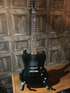 <p>Rare Gibson SGX built in 2000 in the USA. This is a completely different animal to a normal SG with its 24 fret neck and just a single humbucker. The coil tap on this guitar gives a great single coil, almost P90 tone so its a lot more versatile than it would first appear. </p> <p>Has the typical headstock delamination common in this era and has laquer checking on the body and several small marks as you'd expect for a 17 year old guitar. None of these are through to the wood though. There is a also a 2cm laquer burn on the back where someone has placed the guitar on a cheap stand.</p> <p>Just restrung and setup and plays great with a quite chunky 50's style neck.</p> <p> </p>