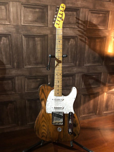 Fender Telecaster with Hipshot B-Bender fitted. Guitar has been stripped and stained at some point in its life but looks great! Has 3 seymour duncan pickups fitted in a Nashville style with a 5 way switch... the neck and middle are stacked and the bridge is quite a hot output varient. Obviously due the new pickup configuration the body has been routed.  The neckplate dates the guitar to 1973 and the body certainly looks to be correct however the neck is dated 1983 which leads us to believe it is either a very early AVRI or JV series neck which has been relogoed with the correct 1973 decal. Whichever neck it is it plays beautifully especially with the jumbo refret it has had!   Fantastic guitar simply dripping with cool and mojo!