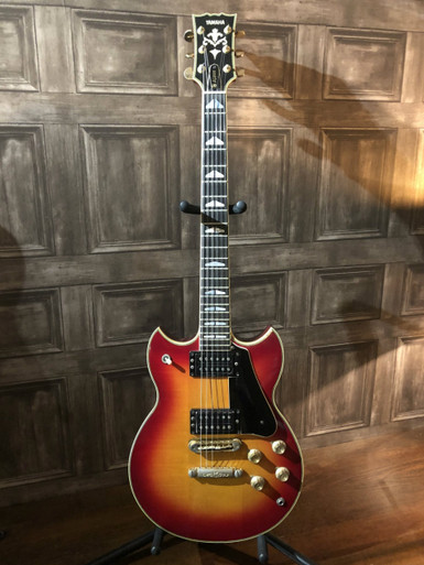 1977 Yamaha SG2000, this is the ultimate Les Paul Killer!   We rarely see original SG2000's anyore and this one is a peach... all original and even comes with the original case! Very little fretwear and has been with the previous owner since 1984 and has been exceptionally well cared for with only a few small marks which we have pictured.  As with all used guitars the pictures provided form part of the description so please study them carefully.