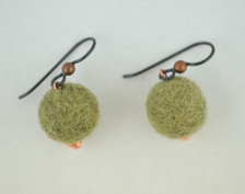Each pair of fuzzy balls are made of genuine wool on French wires, accompanied by our delightfully tacky packaging.
