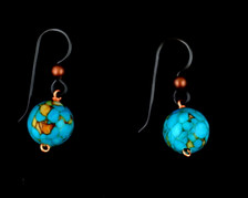 Each pair of turquoise colored balls consists of turquoise colored magnesite on French wires, accompanied by our delightfully tacky packaging.