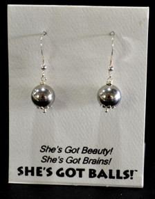 """Each pair of steel  balls consists of stainless steel on French wires, accompanied by our delightfully tacky packaging. Our balls come mounted on this card, with the inscription """"She's Got Beauty! She's Got Brains! She's Got Balls!"""""""