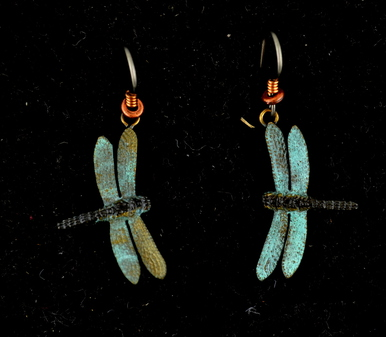 """Cavin Richie's carving reveals the delicate wing structure of this dragonfly captured in mid-flight. The earring hooks are made from gray niobium (hypoallergenic) with heishi beads and coils. The earrings are 1"""" from wingtip to wingtip, cast in lightweight artist's bronze. Casting was created from one of Cavin's original shed-elk antler or woolly mammoth ivory carvings, to give the finished product more natural detail than is possible with a wax carving. Cast in the USA and hand finished in Washington State."""