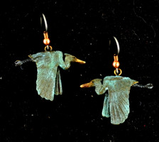 """Cavin Richie flying heron earrings on French wires, cast in lightweight artist's bronze, 0.72"""" X 1.2"""".  The earring hooks are made from gray niobium (hypoallergenic) with heishi beads and coils.  Casting was created from one of Cavin's original shed-elk antler or  woolly mammoth ivory carvings, to give the finished product more natural detail than is possible with a wax carving. Cast in the USA and hand finished in Washington State."""