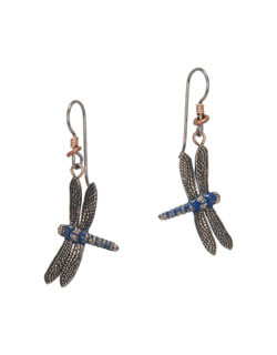 A beautiful blue patina and highly detailed wings give these earrings a stunning realism. The size is 1 inch high and ⅝ inch wide. Heishi beads accent the gray niobium hooks. A beautiful blue patina and highly detailed wings give these earrings a stunning realism. The size is 1 inch high and ⅝ inch wide. Heishi beads accent the gray niobium hooks.  Cast in lightweight artist's bronze. Casting was created from one of Cavin's original shed-elk antler or woolly mammoth ivory carvings, to give the finished product more natural detail than is possible with a wax carving. Cast in the USA and hand finished in Washington State.