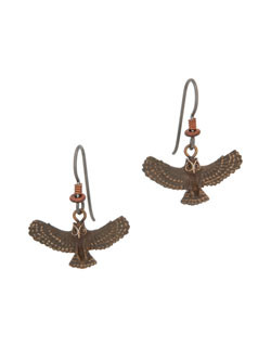 These great horned owl earrings by Cavin Richie are about ½ inch by1.0 inch in size. Heishi beads accent the gray niobium (hypoallergenic) hooks. Cast in lightweight artist's bronze. Casting was created from one of Cavin's original shed-elk antler or woolly mammoth ivory carvings, to give the finished product more natural detail than is possible with a wax carving. Cast in the USA and hand finished in Washington State.