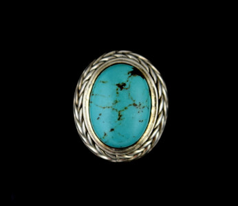 "Sterling silver ring with oval turquoise stone 0.7"" X 0.5"", surrounded by a wheat design."