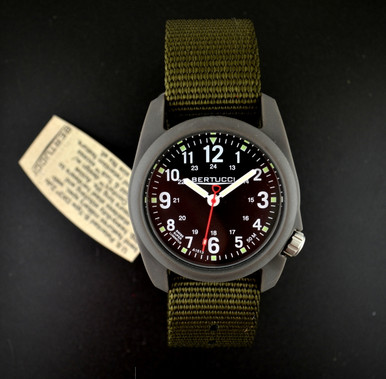 This Bertucci DX3 Field Watch features unmatched performance and value. With classic Bertucci styling and a rugged design, this affordable sports watch's poly resin and fiber body is artistically sculpted and water resistant to 50 meters.  Beautifully designed in the heart of Chicago, every Bertucci watch is perfect for any occasion whether it be a hunting trip in the Northwoods or an elegant dinner engagement. The interchangeable bands slip into the watch body without attachment pins. Water resistant to 50 meters. Made in the USA. Three-year warranty.  Black dial, black nylon band.