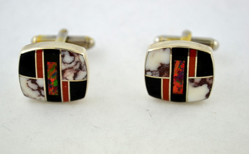 One of a kind, authentic Native American handcrafted cuff links, created by Navajo artists from silver, onyx, white turquoise, spiny oyster shell and created opal. The dominant color motif is black, red and white. 0.7 X 0.6 inches. From Albuquerque, New Mexico.