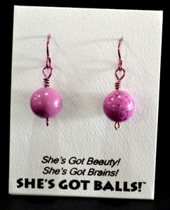 "Each pair of pepto pink balls  comes on French wires, accompanied by our delightfully tacky packaging. Our balls come mounted on this card, with the inscription ""She's Got Beauty! She's Got Brains! She's Got Balls!"""