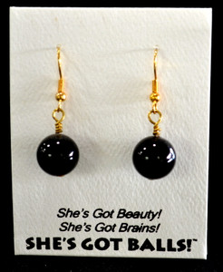 "Each pair of black onyx balls consists of genuine onyx on French wires, accompanied by our delightfully tacky packaging. Our balls come mounted on this card, with the inscription ""She's Got Beauty! She's Got Brains! She's Got Balls!"""