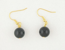 Each pair of black onyx balls consists of genuine onyx on French wires, accompanied by our delightfully tacky packaging