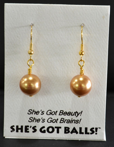 "Each pair of gold  balls consists of high quality created Swarovski pearls on French wires, accompanied by our delightfully tacky packaging. Our balls come mounted on this card, with the inscription ""She's Got Beauty! She's Got Brains! She's Got Balls!"""