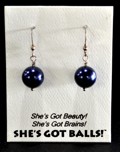 """Each pair of dark blue balls consists of high quality created Swarovski pearls on French wires, accompanied by our delightfully tacky packaging. Our balls come mounted on this card, with the inscription """"She's Got Beauty! She's Got Brains! She's Got Balls!"""""""