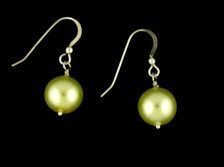 Each pair of key lime  balls consists of high quality created Swarovski pearls on French wires, accompanied by our delightfully tacky packaging.