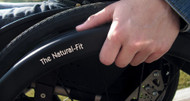 Ergonomic grip incorporates two components, an oval and a thumb piece that sits between the oval and the wheel rim and reduces effort to grip to the rim. The Natural-Fit's ergonomic grip makes it possible to cover the same ground with less work and less fatigue.