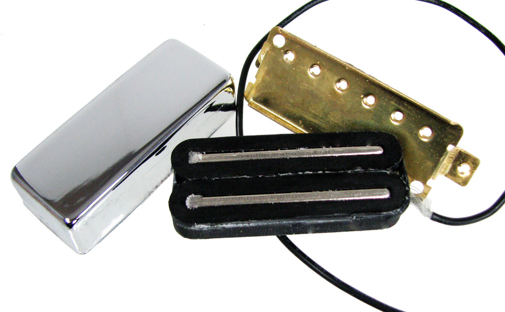 """Here's the """"under the hood"""" view of these pickups. Two separate coils around parallel steel bars with a shared ferrite magnet between them."""