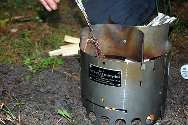 tending to wood fuel in littlbug stove