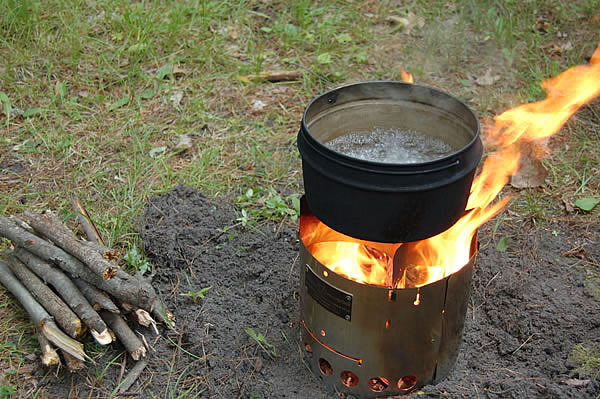 water boiling in metal pot on littlbug stove
