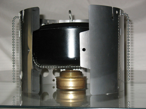 Inside view of Littlbug Senior wood backpacking stove being used with alcohol burner, pot and pot sling.
