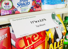 """Clear retail sign sleeve clips into standard 1.25 inch channels and displays large 11""""w x 3.5""""h  signs on retail shelves."""