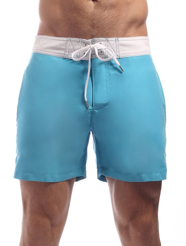 Men's Swim Shorts - Front view Cocksox CSX Retro Boardshort in endless blue – Stylish slim fitting mid-thigh board shorts for the beach or club.