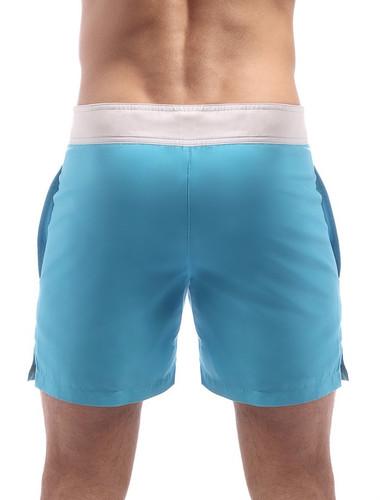 Men's Swim Shorts - Rear view Cocksox CSX Retro Boardshort in endless blue – Stylish slim fitting mid-thigh board shorts for the beach or club.