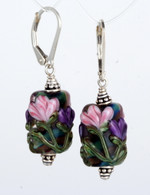 pink and purple floral lampworked rectangular earrings with teal and black background