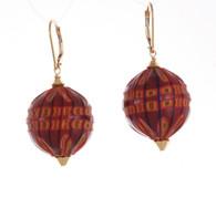 Maroon and yellow/orange sculpted spherical earrings