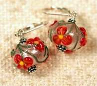 Orange flowers with spherical white sparkle background