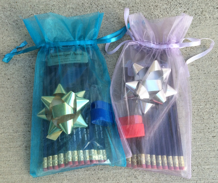 Pretty gift pouches enhance the appeal of a personalized pencil gift.  A small, plastic pencil sharpener and a gift bow are included.