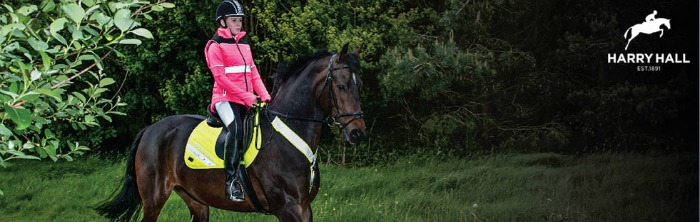 Child riding their horse wearing reflective Harry Hall clothing