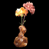 "Handmade pottery vase ""Twisted,"" shown with silk flowers"