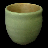 Handmade small ceramic planter with drainage holes