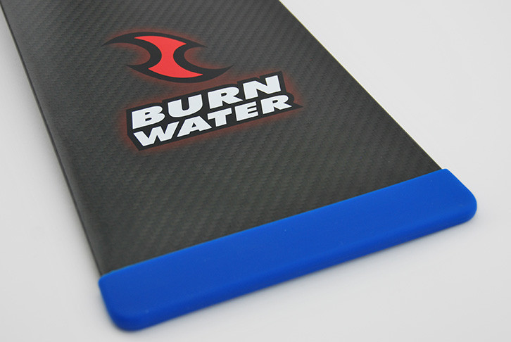 Blue removable silicon paddle blade tip protector - side view. Durable and lightweight. Protects the blade edge from damage when dragon boat paddle not in use.